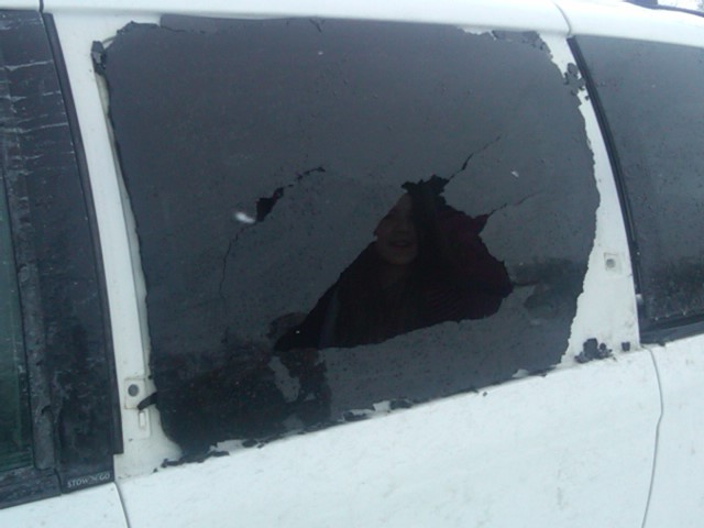 window shattered by a semi