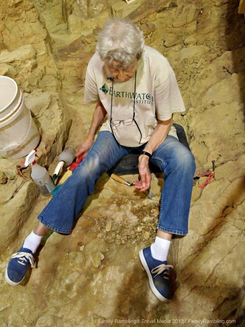 Earthwatch volunteer carefully digs at the Mammoth Site
