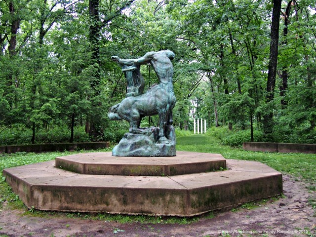 Death of the Last Centaur sculpture sits in a woodland clearing, each end of the path marked with pillars. Allerton Park & Retreat Center, Monticello, IL