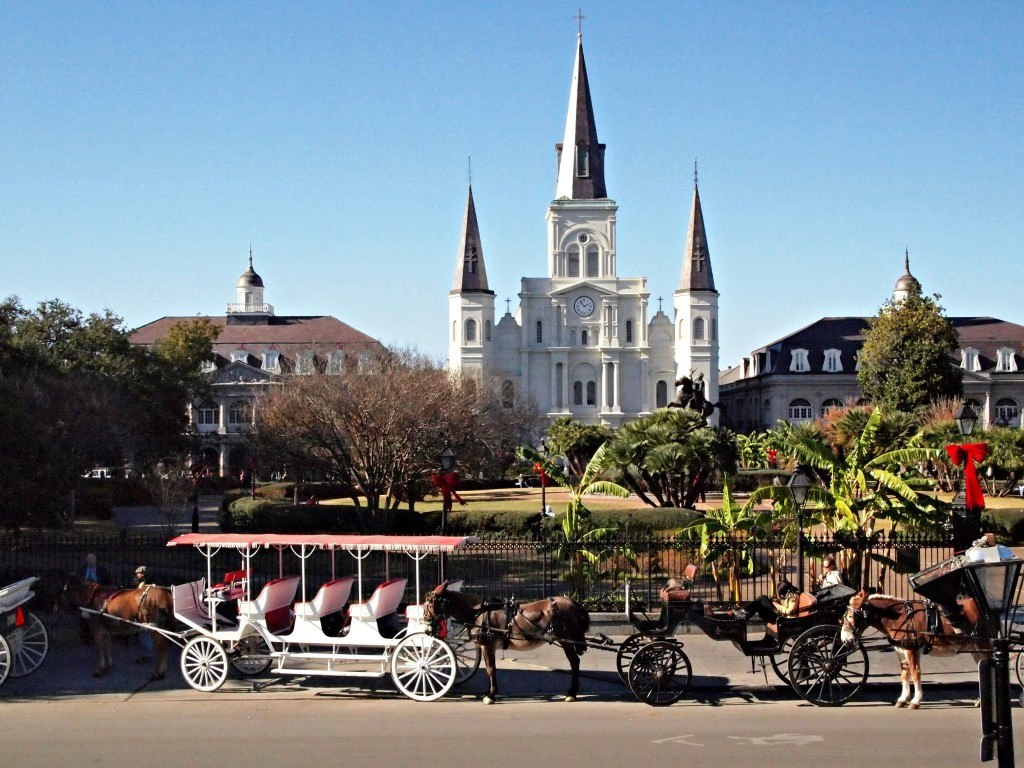 Carriages lined up at Jackson Square in New Orleans. New Orleans Christmas travel tips.