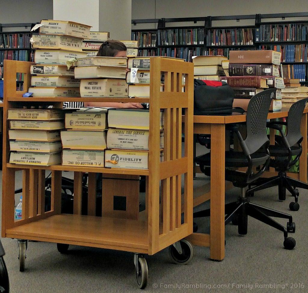 Piles of books hide genealogists at The Genealogy Center in Fort Wayne, Indiana.