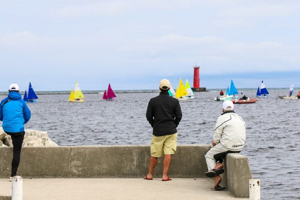 Sheboygan_Wisconsin_men_watching_sailboats_lighthouse