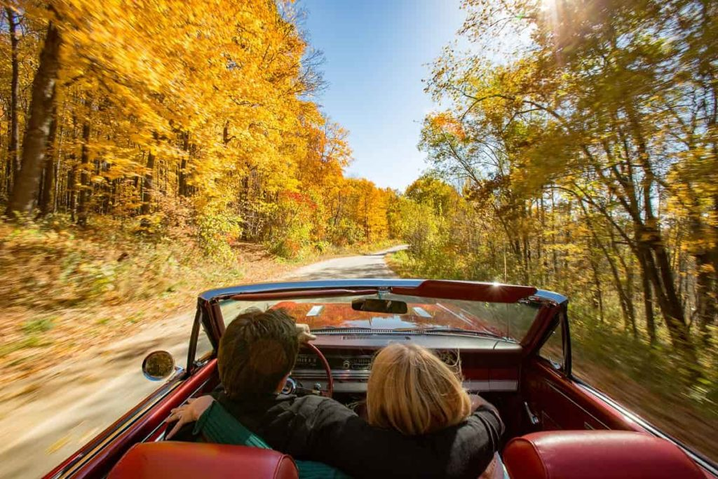 Convertible Driving through Fall Color _credit Travel Wisconsin